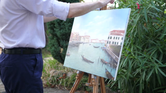 Details of oil painting of Venice, Italy on an easel in a garden. - Slow Motion