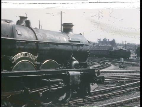 vidéos et rushes de ws pov details of railway station people of platform and high speed steam trains / seaton, devon, england  - locomotive