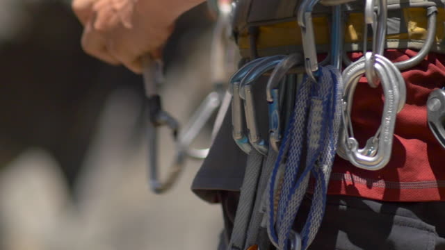 details of rock climbing equipment. - slow motion - climbing equipment stock videos and b-roll footage