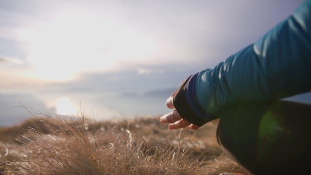 details of woman in yoga pose on top of mountain - mountain pose stock videos & royalty-free footage
