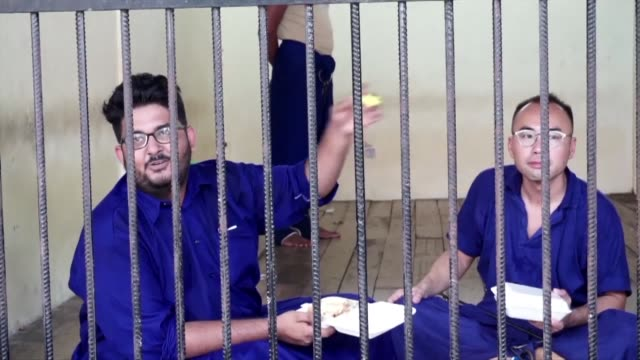detained journalists in myanmar wait for their next hearing due monday 20 november in an ongoing trial for flying a drone over parliament - gefangener stock-videos und b-roll-filmmaterial