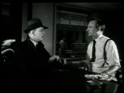 1948 b/w detective flashing badge at bartender who offers him a drink / new york city, new york, united states - detektiv stock-videos und b-roll-filmmaterial
