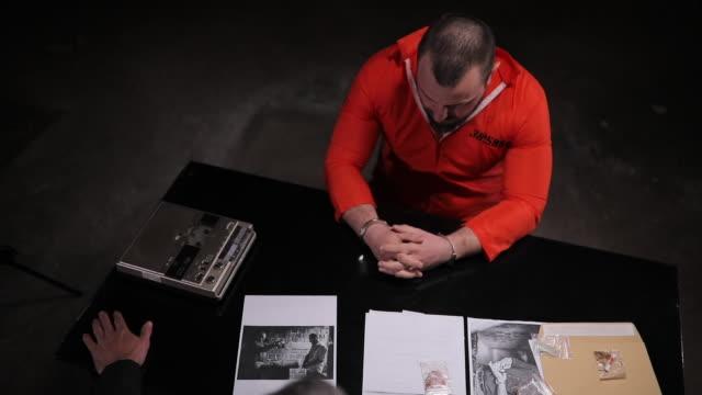 detective interrogating prisoner in interrogation room - evidence bag stock videos & royalty-free footage
