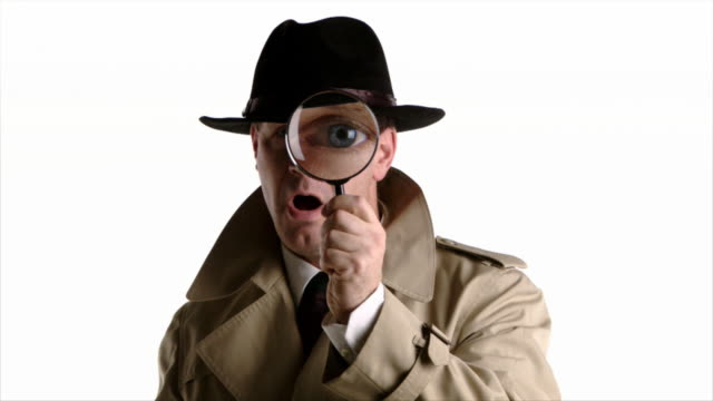 detective looks through magnifyer - magnifying glass stock videos & royalty-free footage