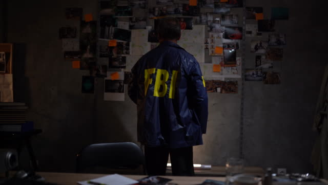 fbi detective solving a crime - fbi stock videos & royalty-free footage