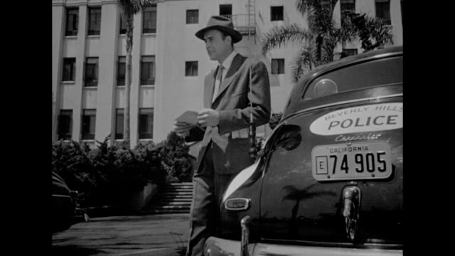 1948 a detective tirelessly attempts to solve a murder investigation - 1948 stock-videos und b-roll-filmmaterial