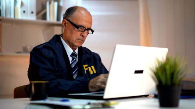 detective using laptop - fbi stock videos & royalty-free footage