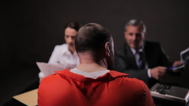 detectives and prisoner in interrogation room - confession law stock videos & royalty-free footage