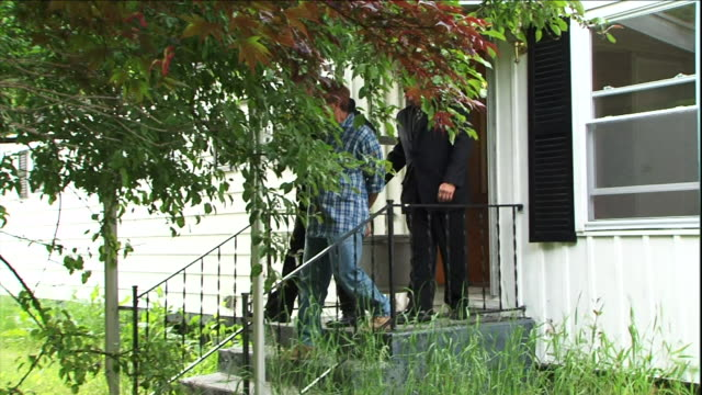 detectives escort a suspect from a house. - suspicion stock videos & royalty-free footage