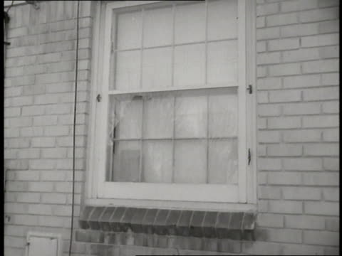 detectives inspect broken house windows after the assassination attempt of labor union leader walter reuther in detroit, michigan. - 1948 stock videos & royalty-free footage