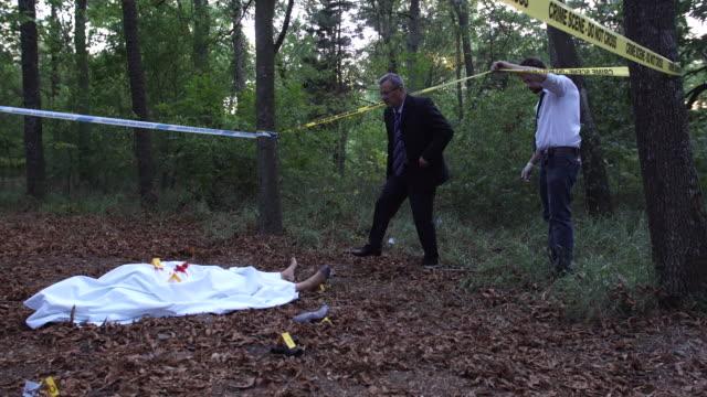 detectives on the murder scene 4k - non urban scene stock videos & royalty-free footage
