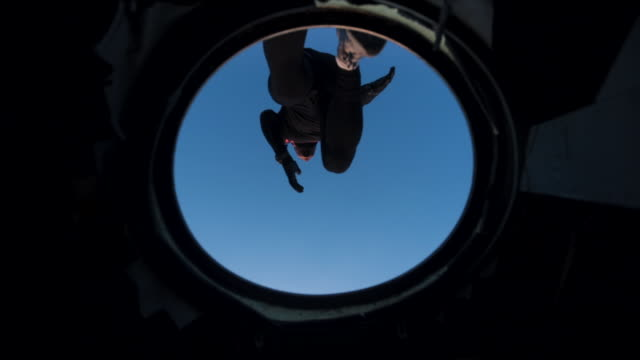 determinated athlete running on a abandoned airplane - aereo militare video stock e b–roll
