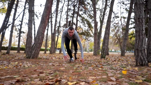 determined amputee athlete getting up from a fall while running - autumn stock videos & royalty-free footage