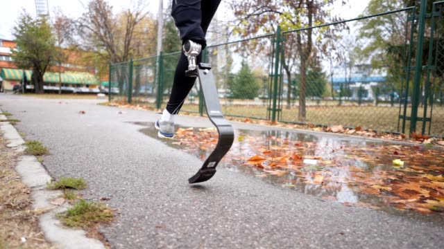 determined amputee athlete running outdoors - artificial limb stock videos & royalty-free footage