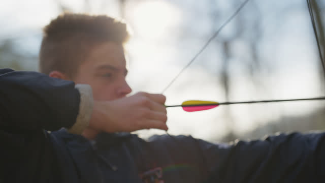 cu determined boy aims and releases bow and arrow - one teenage boy only stock videos & royalty-free footage