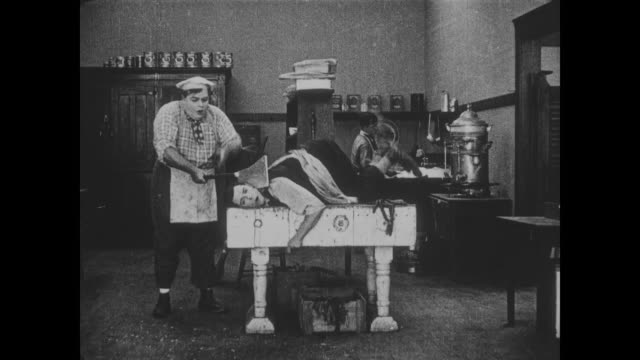 1918 determined chef (fatty arbuckle) swings kitchen knife nearly killing a flustered waiter (buster keaton) - kitchen stock videos & royalty-free footage