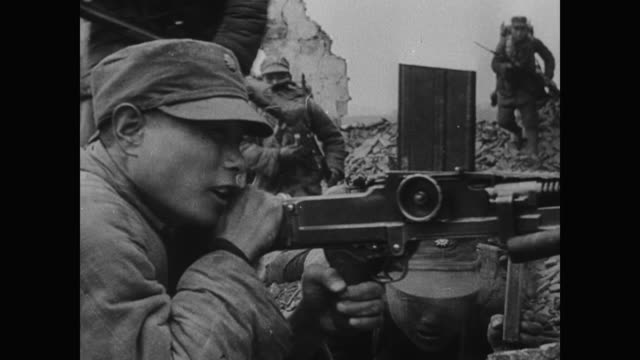 WWII Determined Chinese workers build airfields from rocks with their bare hands as Guerilla fighters and regular soldiers continue to face down the...