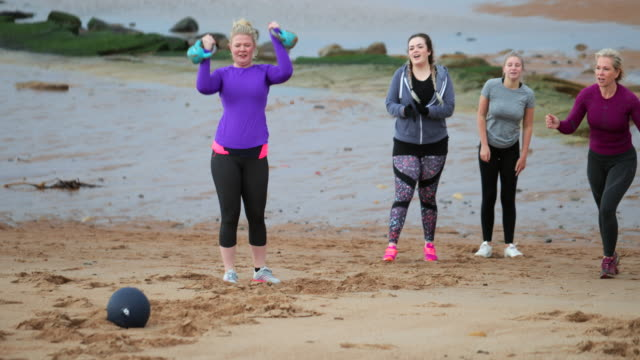 Determined Females Doing Fitness on the Beach