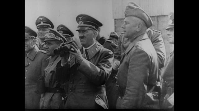 vídeos de stock, filmes e b-roll de a determined german invading force as adolf hitler along with general walther von reichenau watch from a distance - polônia