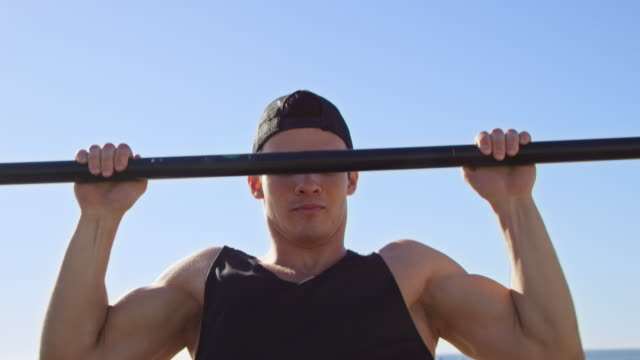 determined man doing chin-ups on jungle gym - 20 24 years stock videos & royalty-free footage