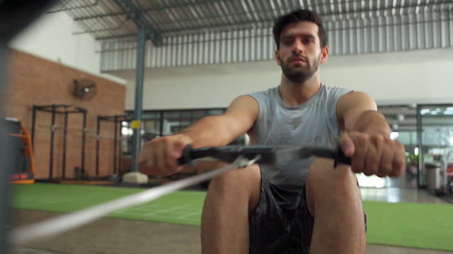 determined man doing exercises in gym. - durability stock videos & royalty-free footage