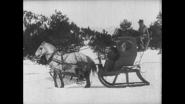 1922 Determined man (Buster Keaton) follows couple to cabin by horse and carriage