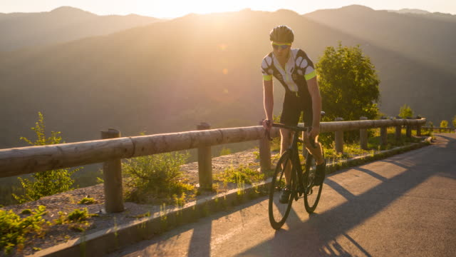determined road cyclist cycling uphill - uphill stock videos & royalty-free footage
