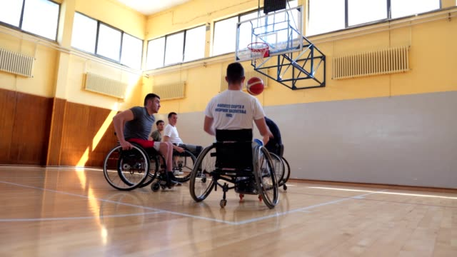 determined wheelchair athletes playing basketball - wheelchair basketball stock videos & royalty-free footage