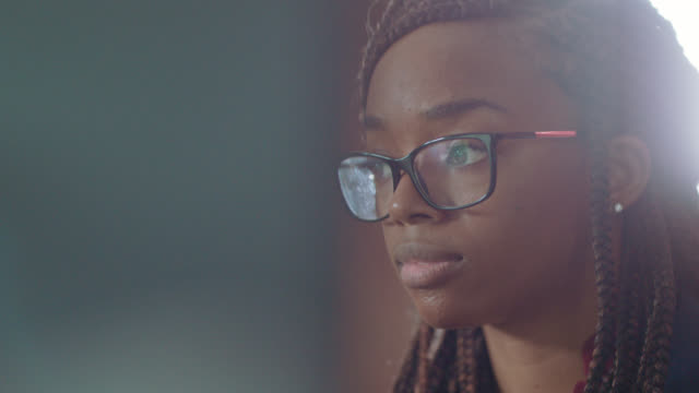 cu determined young african-american woman works intently on her computer - business person stock videos & royalty-free footage