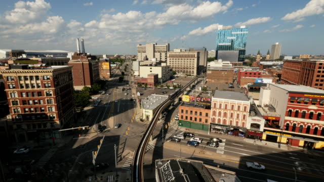 detroit people mover passing through downtown. extreme wide shot from above - elevated train stock videos & royalty-free footage