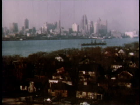 vídeos de stock, filmes e b-roll de 1951 ha detroit skyline and harbor / michigan, united states - 1951