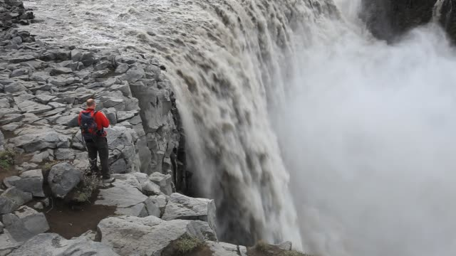 dettifoss waterfall, the largest in europe by volume, with a drop of 47 metres and an average discharge of 200 metres cubed per second. it is 100... - water stock videos & royalty-free footage