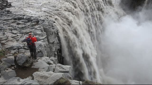 Dettifoss waterfall, the largest in Europe by volume, with a drop of 47 metres and an average discharge of 200 metres cubed per second. it is 100 metres wide and takes meltwater in the river Jokulsa a Fjollum from the Vatnajokull ice sheet