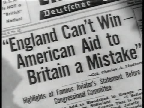 deutscher weckruf und beobachter publishing' on office window. headline 'england can't win-american aid to britain a mistake' . male buying newspaper... - 反ユダヤ主義点の映像素材/bロール