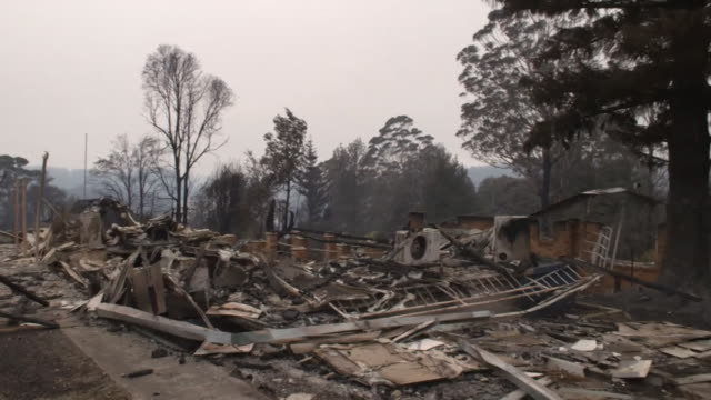 """devastation and damage after bush fires went through houses in lake conjola, new south wales, australia - """"bbc news"""" stock videos & royalty-free footage"""