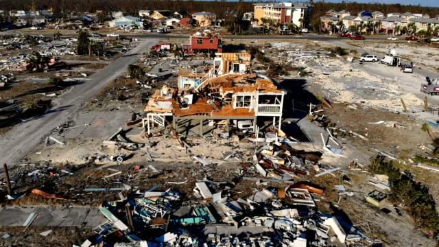 vidéos et rushes de devastation left in the wake of hurricane michael is shown from above on october 15 2018 in mexico beach florida the death tolls stands at 18 blamed... - démoli