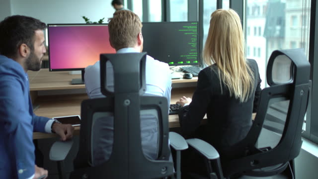 developers at work, 4k - it support stock videos and b-roll footage