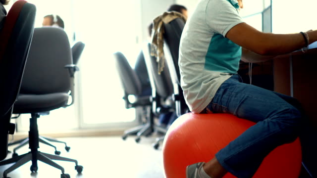 developers at work. - pallone per fitness video stock e b–roll