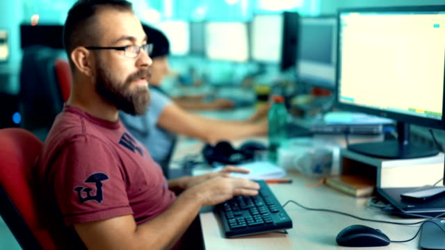 developers at work. - profilo vista laterale video stock e b–roll