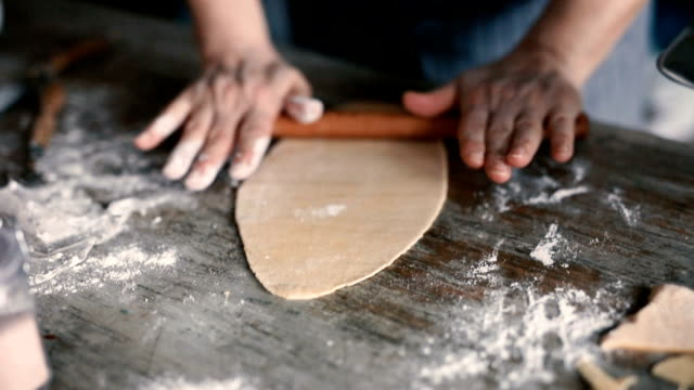developing dough with a rolling pin