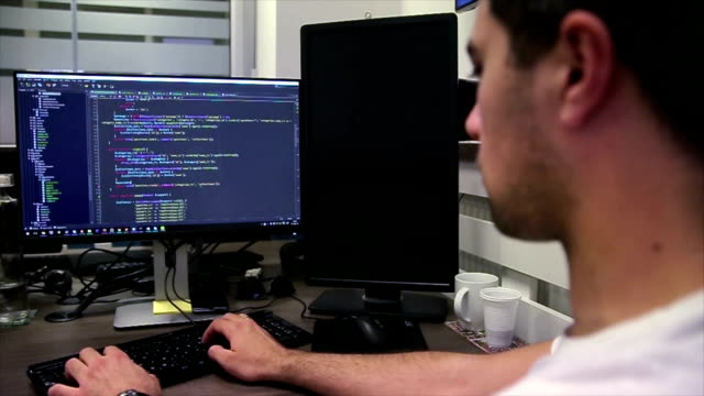 Developing programming and coding technologies. Website design. Programmer working in a software develop company office.