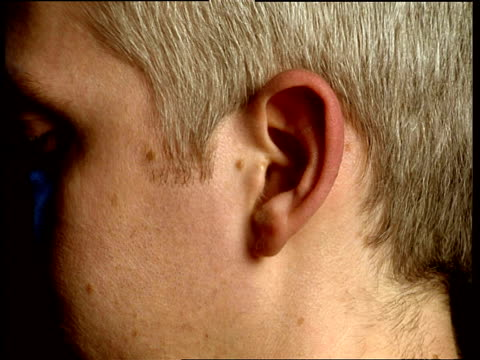 Development of man's ear over time showing the aging process from young boy to elderly man