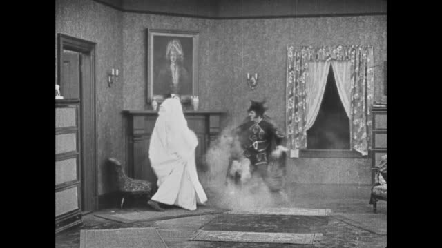 1921 devil and ghost simultaneously scare each other - 1921 stock-videos und b-roll-filmmaterial