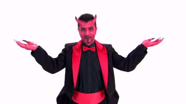devil shrugging - shrugging stock videos and b-roll footage