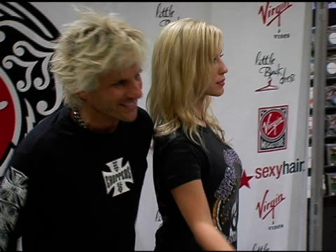 deville and guest at the virgin girls rock fashion show at virgin records in hollywood, california on may 4, 2006. - ヴァージンレコード点の映像素材/bロール