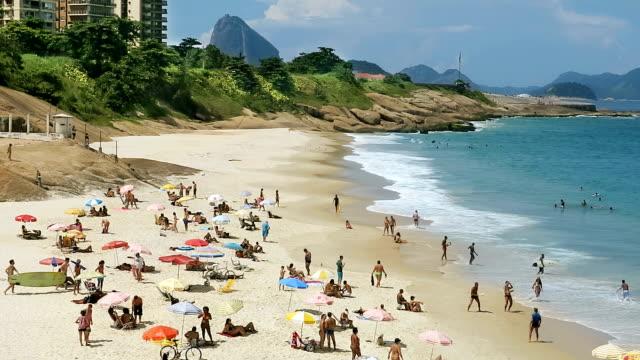 devil's beach in rio de janeiro - sunbathing stock videos & royalty-free footage