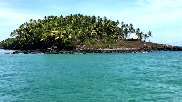 devil's island seen from the ship. ruins of penal colony on the coast - devil's island french guiana stock videos & royalty-free footage