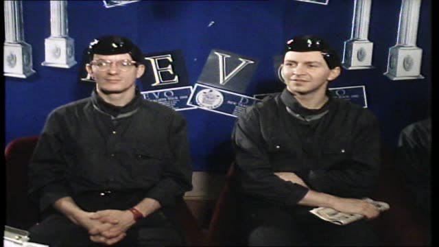 devo interview with donnie sutherland band wearing newlook jfk inspired hairdos re likes and dislikes and the direction of their band - pop musician stock videos & royalty-free footage