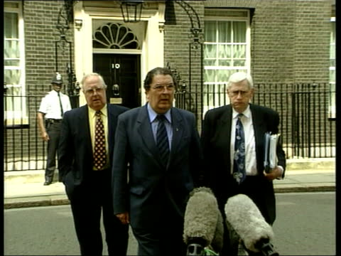 devolution bill downing street sdlp leader john hume mp from number 10n with deputy leader seamus mallon and another pull out as towards john hume mp... - john hume stock videos & royalty-free footage