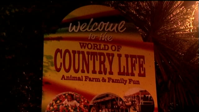 sign at entrance to world of country life animal farm and car